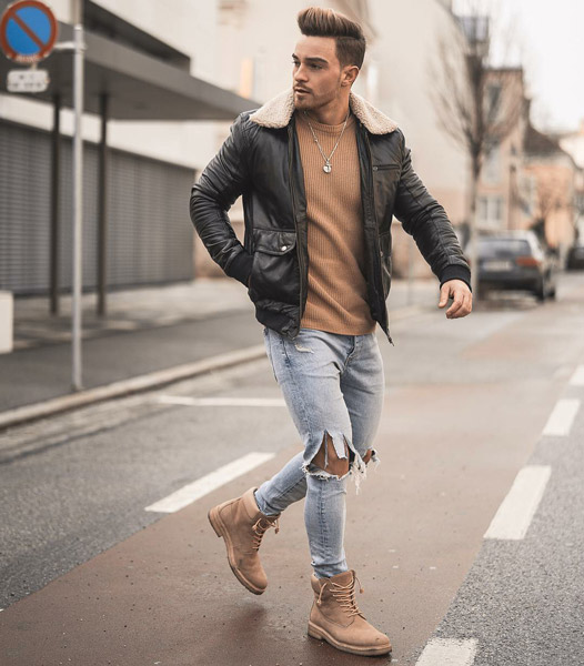 light blue jeans with brown boots